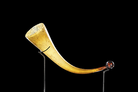 47 Roman drinking horn made of amber-coloured glass. 3rd to 4th cent. AD. Estimate: 12.000 Euro. Final Price: 76.700 Euro