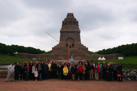 The participants in front of the monument of the Battle of the Nations