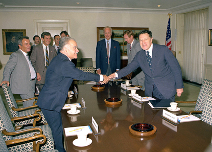 Secretary of Defense Caspar Weinberger (right) greets Minister of Foreign Affairs Yitzhak Shamir of Israel in a Pentagon Conference Room, room 3E912. Photo: Frank Hall.