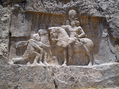 A rock relief at Naqsh-e Rostam (Iran) depicts the triumph of Shapur I over the Roman emperor Valerian. Photograph: Fabienkhan / http://creativecommons.org/licenses/by-sa/2.5/deed.en