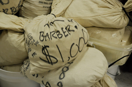 Some bags are filled with Barber Quarters or other denominations.