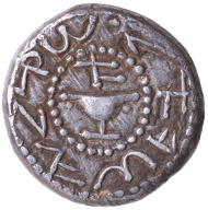 The First Jewish Rebellion. Shekel, minted in Jerusalem, year 1 (AD 66). Obverse: goblet, above it aleph (year 1); Paleo-Hebrew: Shekel of Israel reverse: branch with three pomegranates; Paleo-Hebrew: Jerusalem is sacred. © Israel Museum, Jerusalem.