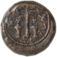 The First Jewish Rebellion. Half-Shekel, minted in Jerusalem, year 4 (AD 69-70). Obverse: palm tree, two baskets with dates, Paleo-Hebrew: For the Deliverance of Zion. Reverse: etrog fruit, two Lulav-bundles; Paleo-Hebrew: year 4, Half[-Shekel]. © Israel Museum, Jerusalem.