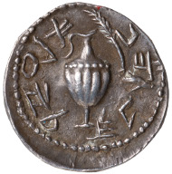 Second Jewish Rebellion. Zuz, minted in Jerusalem, AD 133. Obverse: ewer; Paleo-Hebrew: Shimeon. Reverse: Paleo-Hebrew: for the freedom of Jerusalem. © Israel Museum, Jerusalem. At times Roman denarii were re-struck; this made the production of planchets obsolete, but they also literally overlay the colonial power, making it unnecessary to spell out the political message.