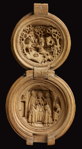 Rosary bead or prayer-nut; boxwood; carved. 1490-1530. Opening in two halves: St Hubert adoring the stag and enthronement of St Hubert. The Waddesdon Bequest. © The Trustees of the British Museum.