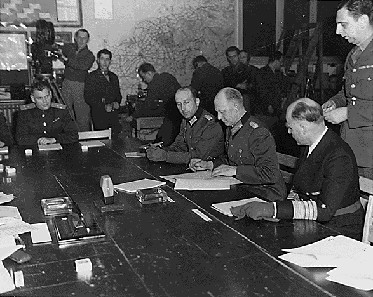Colonel General Jodl signs the instruments of unconditional surrender in Reims on 7 May 1945.