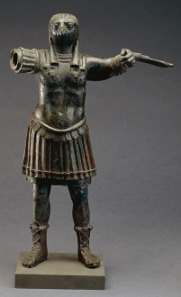 Standing figure of the ancient Egyptian god Horus, wearing Roman military costume bronze, Egypt, 1st-2nd century AD. © The Trustees of the British Museum.