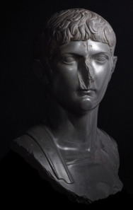 Bust of Germanicus, great-nephew of Augustus with a later Christian cross carved onto the forehead, basalt, Egypt, about AD 14-20, date of carved cross, unknown. © The Trustees of the British Museum.