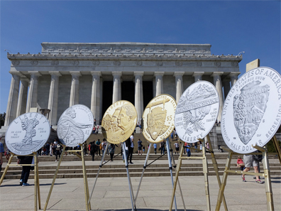Large prints of the 100th Anniversary of the National Park Service Commemorative Coins are displayed at the Lincoln Memorial during the ceremonial opening of sales March 24, 2016. The second of two commemorative coin programs for 2016, surcharges from the sale of the coins have been authorized to be paid to the National Park Foundation. U.S. Mint photo by Sharon McPike.