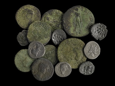A hoard of Iron Age and Roman coins found in Owermoigne, Dorset, in 2010. © The Trustees of the British Museum.