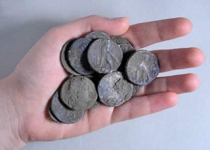 The coin hoard before cleaning. Photo: Clara Amit, Israel Antiquities Authority.