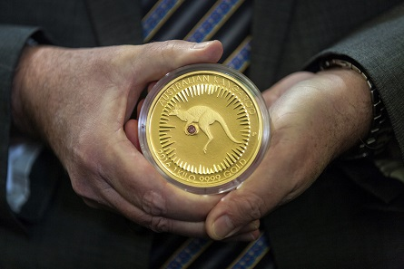 Perth Mint Chief Executive Officer, Richard Hayes holding the Kimberley Treasure coin.