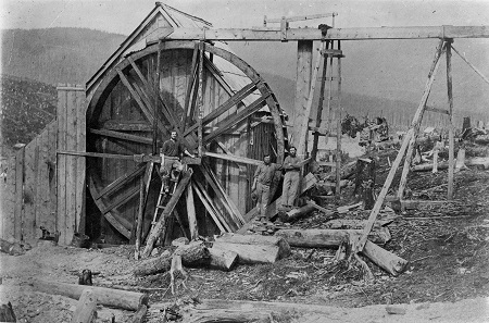 Wheel and flumes at the Davies claim on William's Creek, 1867. Image A-00558 courtesy of the Royal BC Museum and Archives.