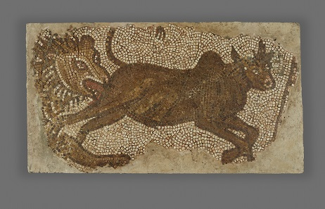 Lion Chasing a Bull. Roman, from Syria, possibly Emesa (present-day Homs), A.D. 400-600. Stone, 32 x 59 in. The J. Paul Getty Museum, Villa Collection, Malibu, California, Gift of Joel Malter. 75.AH.115.