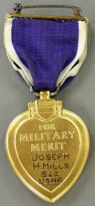 Purple Heart, awarded to Seaman 1st Class Joseph H. Mills who was killed in action on April 12, 1945, when his ship, the destroyer USS Mannert L. Abele, was sunk in a Japanese kamikaze attack during the battle for Okinawa.