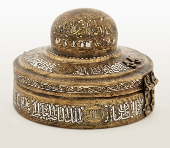 Incense Box. Egypt or Syria, 14th century. Brass, gold, silver, and black compound. H. 2 7/8 in. (7.5 cm), Diam. 41/2 in. (11.5 cm). Museum of Islamic Art, Doha (MW.468.2007). Image: The Museum of Islamic Art, Doha.