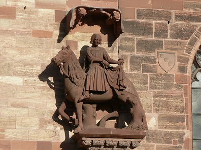 St. Martin splits his coat. Sculpture at the Basel Minster, 1340. Photo: Jacob Burckhardt / CC BY-SA 3.0