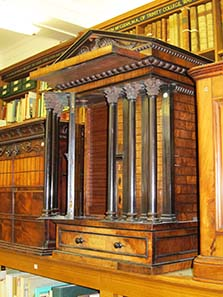 Coin cabinet in the shape of a temple. Image: UK.