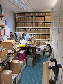 Ted Buttrey in his catalogue room. Image: UK.