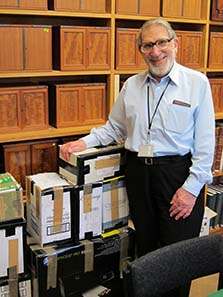 Ted Buttrey with catalogues ready for despatch. Image: UK.