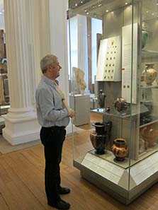 Adi Popescu shows us coins which are incorporated into the show rooms of the Fitzwilliam Museum. Image: UK.