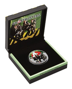 'Ghostbusters (TM)' silver coin in themed packaging.