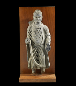 Lot 655: Buddha, Gandhara, ca. 2nd cent, AD. H 51cm, W 19.5 cm, D 9.5 cm. Green grey slate. From the Prof. Dr. Günther Marschall Collection, Hamburg. Acquired 1967-1975. Nimbus, forearms, feet and small parts of coat hem broken. Estimate: 6,000,- euros. Hammer price: 14,000,- euros.