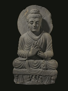 Statue of a seated Buddha preaching, 2nd century – 3rd century, Ghandara, Pakistan. Photo: © Trustees of the British Museum.