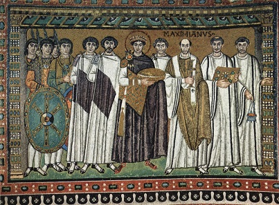 Byzantine Emperor Justinian next to his court officials. Mosaic from San Vitale / Ravenna. Source: Wikipedia.