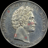 The obverses of two counterfeit 1825 Bavaria Coronation Thalers.