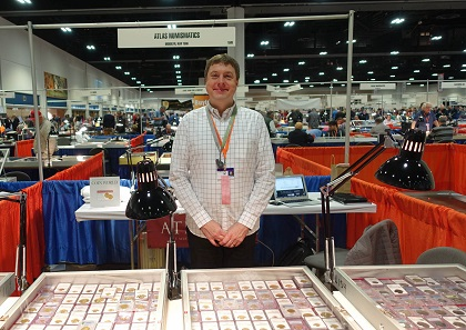 Christopher Baker at the booth of the New York company Atlas Numismatics, which has a table at the FUN despite the fact that many coin dealers are visiting their home town at the same time. Photo: UK.