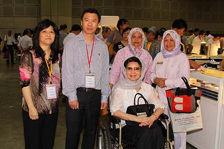 Kitty Quan, CEO of Panda America, Peter Yeung, President of Panda America, HRH the Crown Princess of Pahang, Malaysia, Princess Azizah Iskandar, and her attendants. The Crown Princess attended SICF 2011 to have her gold coins appraised (left to right)