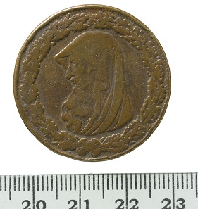 Welsh penny token, Parys Mine Company, 1787. This copper-alloy coin is a Welsh penny token, forged in the late eighteenth-century. It features a hooded bust of a Druid l, within a thick oak leaf wreath with one acorn below the tie. The coin is out of place in the collection in terms of origin, being more modern and from the west. © MOLA.
