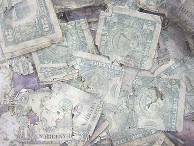 Dollar notes after a water damage. Photograph: UK.