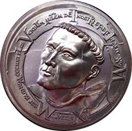 The first medal in the series commemorating the 500th anniversary of the Protestant Reformation shows Martin Luther as a young monk.