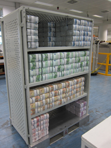 A storage rack with parcels of money. Senseless to reflect on how many millions are gathered here. Photo: UK.