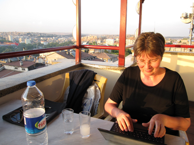 Writing on the diary on the hotel terrace. Photo: KW.