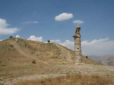 Column with eagle in front of tumulus. Photograph: KW.