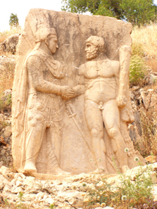 A king of Commagene (Mithridates or Antiochus) clasping hands with Heracles. Photograph: UK.