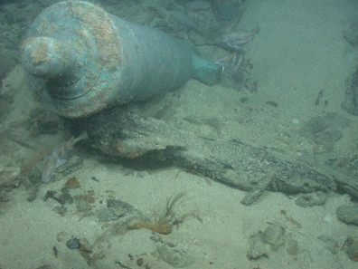 Bronze cannon protruding from a sandbank on the shipwreck site of HMS Victory. Source: Odyssey Marine Exploration, Inc.