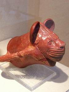Ceramic vessel in the shape of a lioness' head. Photograph: UK.
