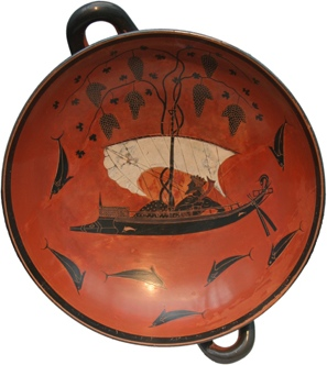 Cup of Exekias. Dionysos sailing on a ship, surrounded by dolphins. Photograph: Matthias Kabel / Wikipedia.