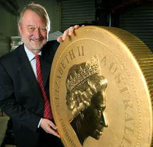 Ed Harbuz, CEO of The Perth Mint, stands beside the massive 1 Tonne Australian Gold Kangaroo Coin.