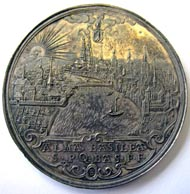 Basel. Medal (43.02 g) without year (c.1645) by F. Fecher. City view at sunrise, above Basel shield hold by the hand of God, in the exergue a decorated field bearing the inscription: ALMA BASILEA / SPQ BAS FF, FF (as monogram). Rv. DEO FAVENTE NEMO / NOCEBIT Prophet Daniel in the lion's den, on his left, king Darius on a balcony between two women (Ewig 803; Haller 1335; Wund. 2185; Leu SM 1052). Copyright Sturzenegger Stiftung / Museum zu Allerheiligen Schaffhausen.
