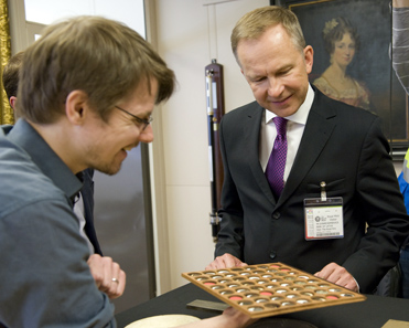 Joseph Payne from the Royal Mint and Ilmars Rimevics, Governor of the Bank of Latvia, admire the historic Latvian coins contained in the Royal Mint Museum during the visit to the Royal Mint on 28 May 2012.