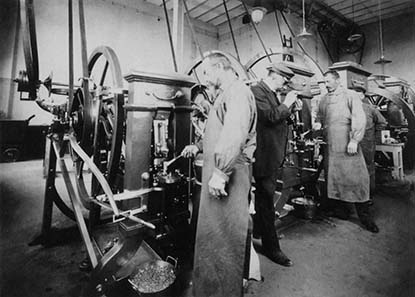 View inside the minting room: knuckle joint presses. Photograph 1908. Burgerbibliothek Bern (Photo album