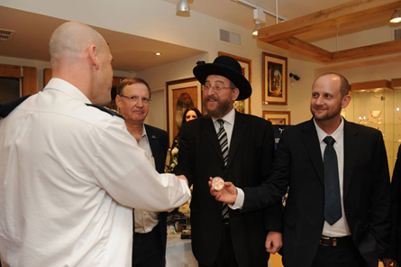 Right Aviv Katz CEO of Israel Coins and Medals, Rabbi Yoram Cohen, Joseph Horowitz, director of business development and marketing Rafael and Lieutenant Colonel Yossi representative of the security forces.