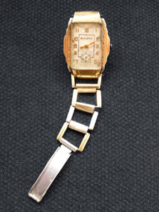 Clyde Barrow's Watch. The watch was worn by Clyde Barrow when he was gunned down with Bonnie Parker in 1934. Only part of the watch is intact because Clyde's hand was shot off in the ambush.