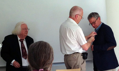 David Hendin receives Gunnar Holst Numismatic Foundation Medal of 2013 from Yngve Karlsson while Foundation President Bengt Holmén looks on.