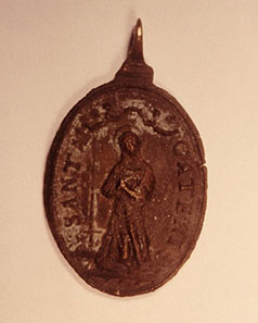 Spanish sailors of the seventeenth century were devoutly religious and the ship's passenger lists often included Catholic clergy. A small brass medallion with religious figures on both sides is an especially prized piece recovered from the